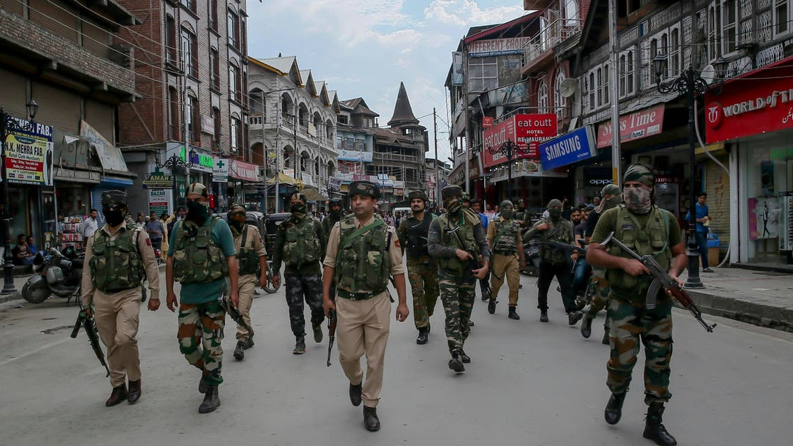 Indian security forces patrol a street in central Srinagar on July 27, 2018. (AP)