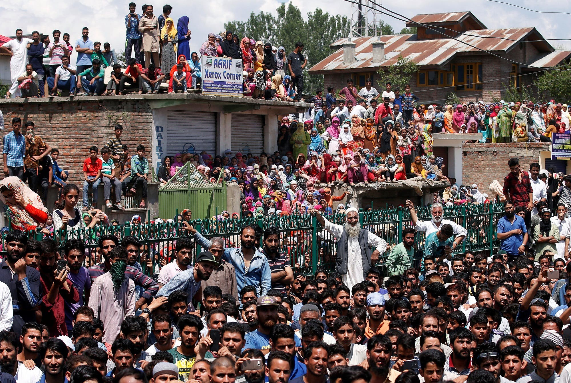 People watch the funeral of Bilal Ahmed, a suspected militant, who according to local media was killed in a gunbattle with Indian security forces, in Khudwani, in south Kashmir's Kulgam district, July 25, 2018. (Reuters)