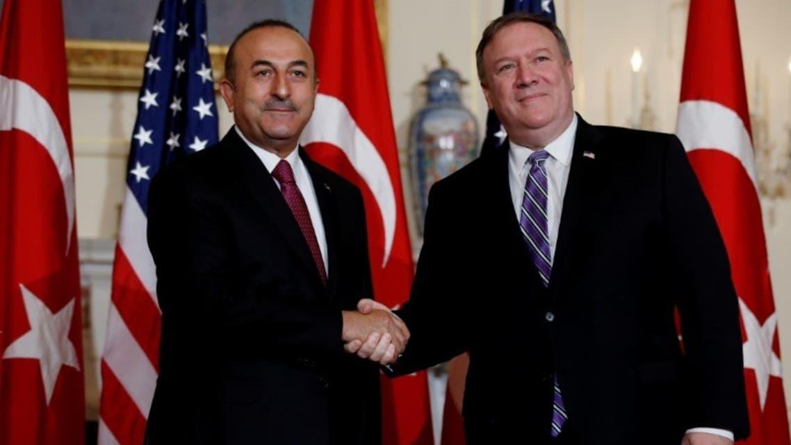 وزير الخارجية التركي يصافح نظيره الأميريكي في واشنطن يوم 4 يونيو
