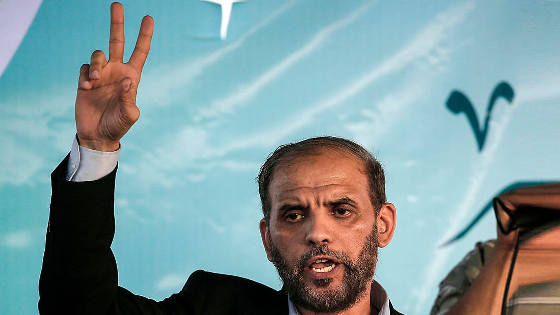 Member of the political bureau of Hamas Husam Badran flashes the V for victory sign near the Israel-Gaza border, east of Gaza city on August 3, 2018. (AFP)