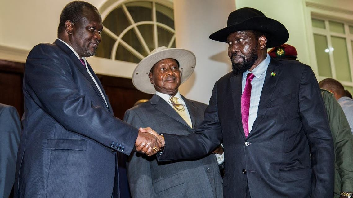 President of South Sudan, Salva Kiir (R) shakes hands with arch-rival South Sudan's opposition leader Riek Machar (L). (AFP)