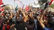 Protesters in oil-rich Basra threaten to block bridges, roads