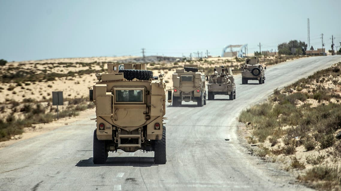 A picture taken on July 26, 2018 shows Egyptian policemen driving on a road leading to the North Sinai provincial capital of El-Arish. (AFP)