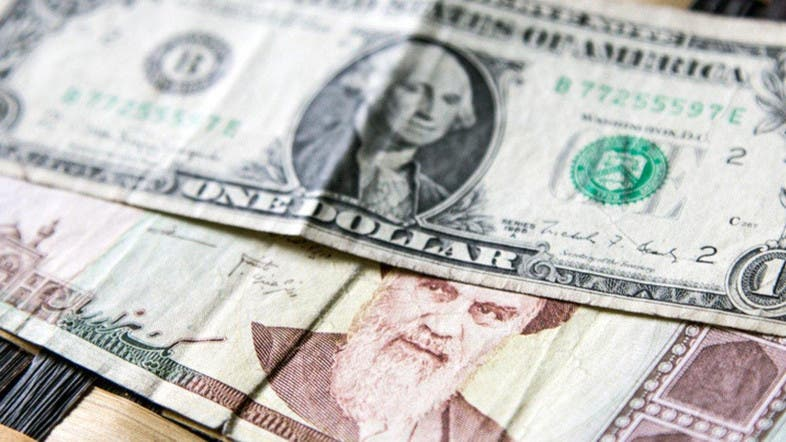 Iranian Currency Hits Record Low At 128 000 Rials To The Dollar