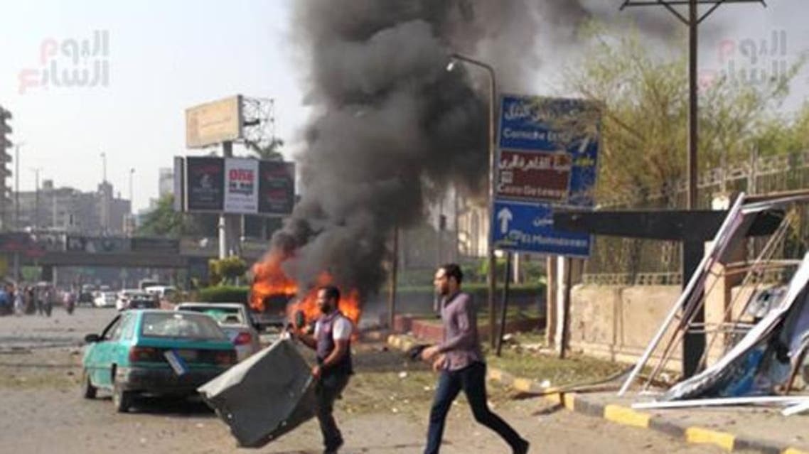 IN PICTURES: Car bomb explodes in Egypt's Dokki neighborhood