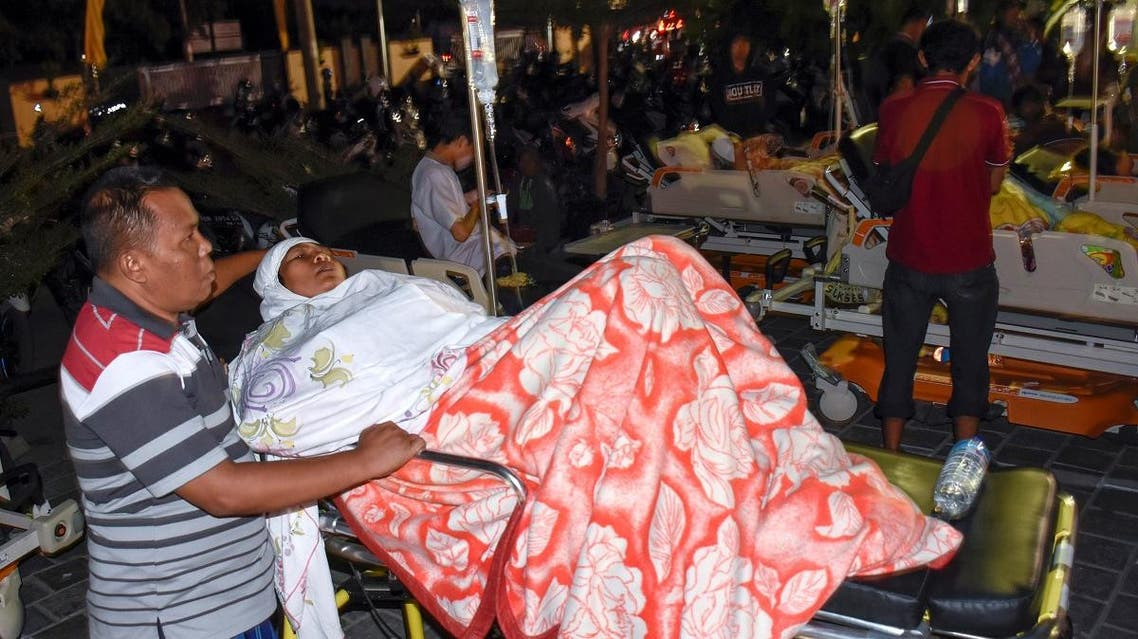 A person injured during a strong earthquake waits for treatment outside the Mataram City hospital with other patients who were evacuated, in Mataram, Lombok island, Indonesia August 5, 2018. (Reuters)
