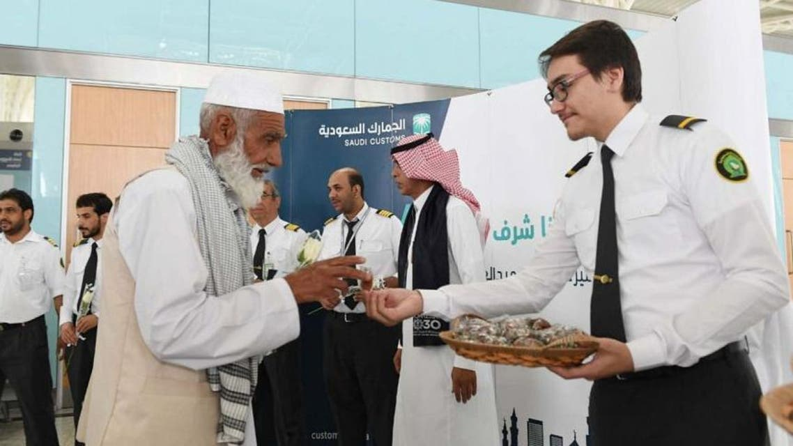 """The airport's customs are carrying the activities under a campaign that tells pilgrims: """"Perform Hajj, we are honored to serve you!"""""""