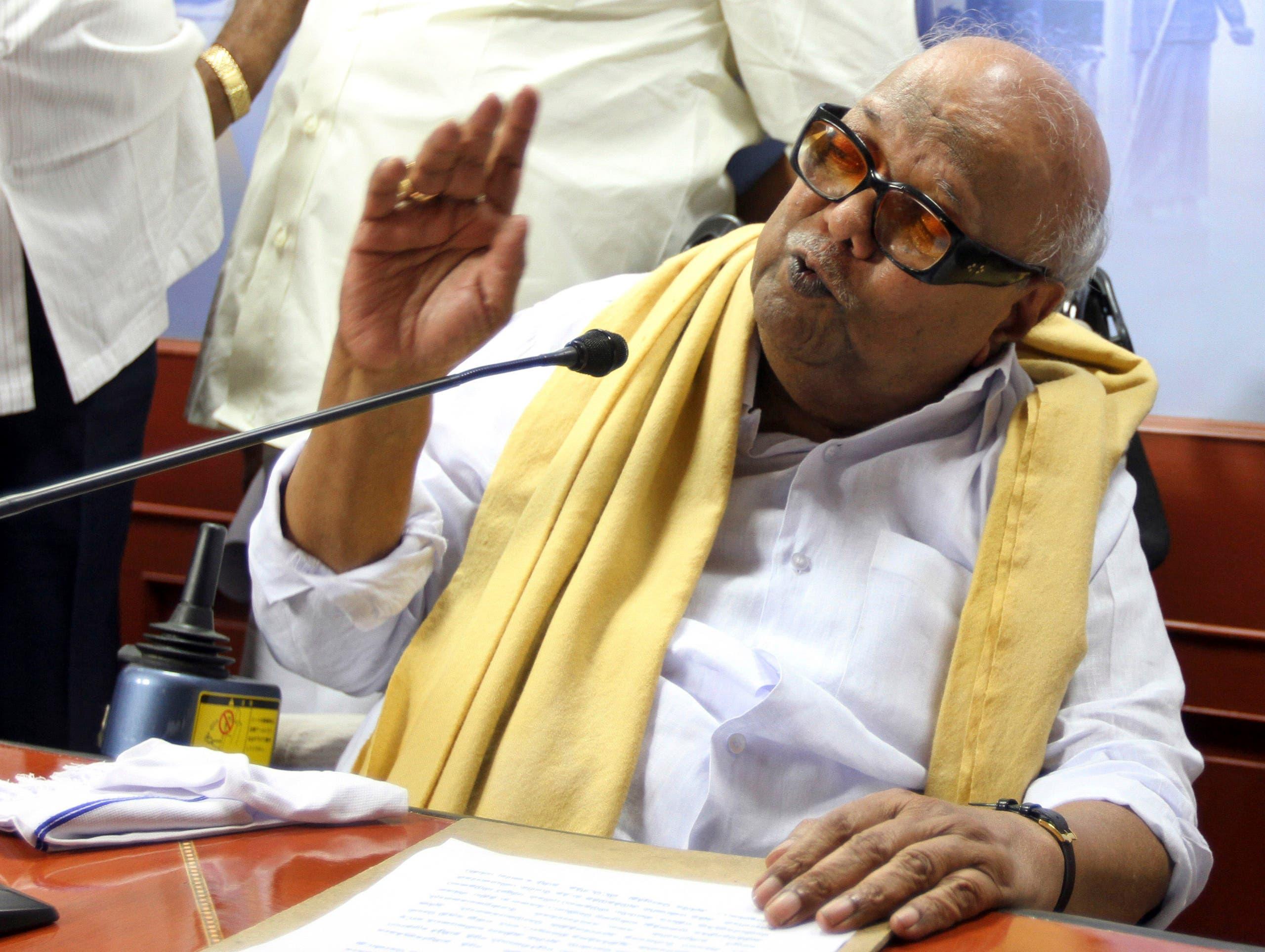 Leader of the Dravida Munnetra Kazhagam party M. Karunanidhi speaks at a press conference. (AP)