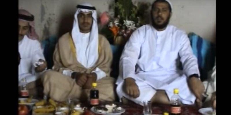 أبومحمد المصري ويجاوره بالمشلح حمزه بن لادن والثالث سعد بن لادن