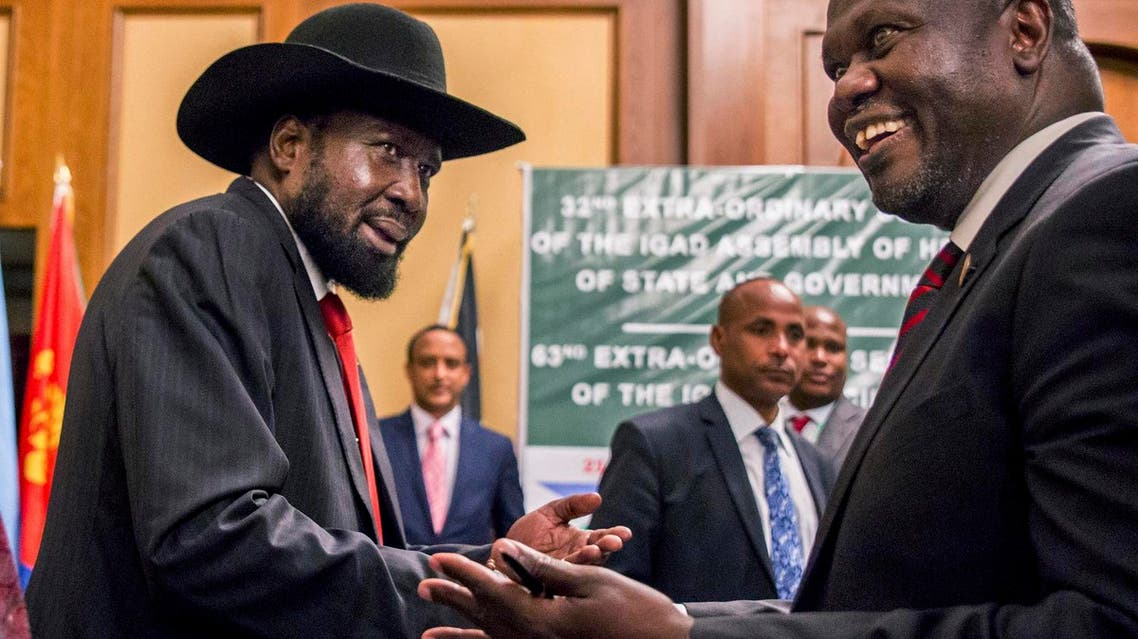 In this file photo dated Thursday, June 21, 2018, South Sudan's President Salva Kiir, left, and opposition leader Riek Machar, right, shake hands during peace talks in Addis Ababa, Ethiopia. (AP)