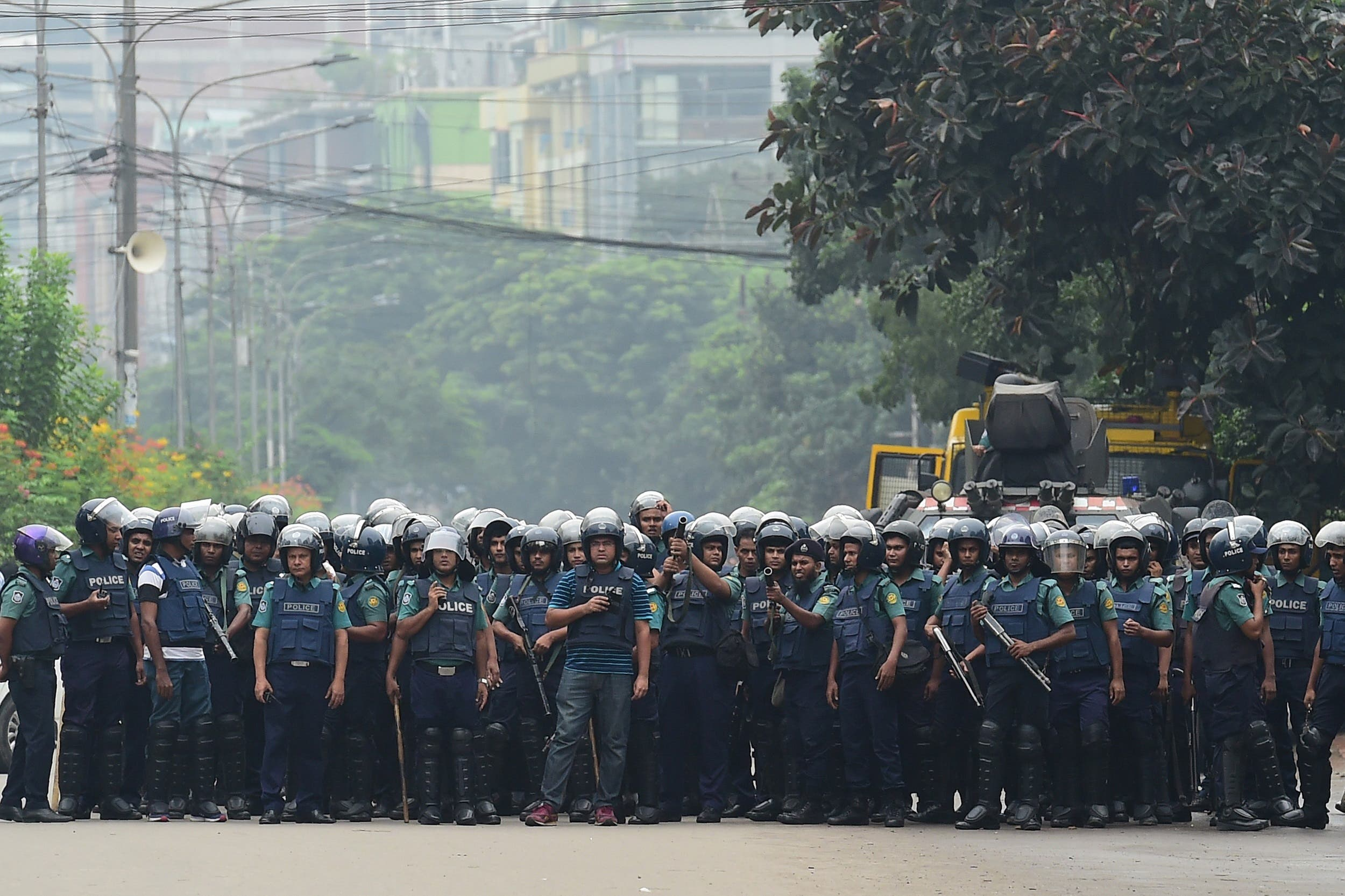 Bangladeshi police stand guard during a student protest in Dhaka on August 5, 2018. (AFP)