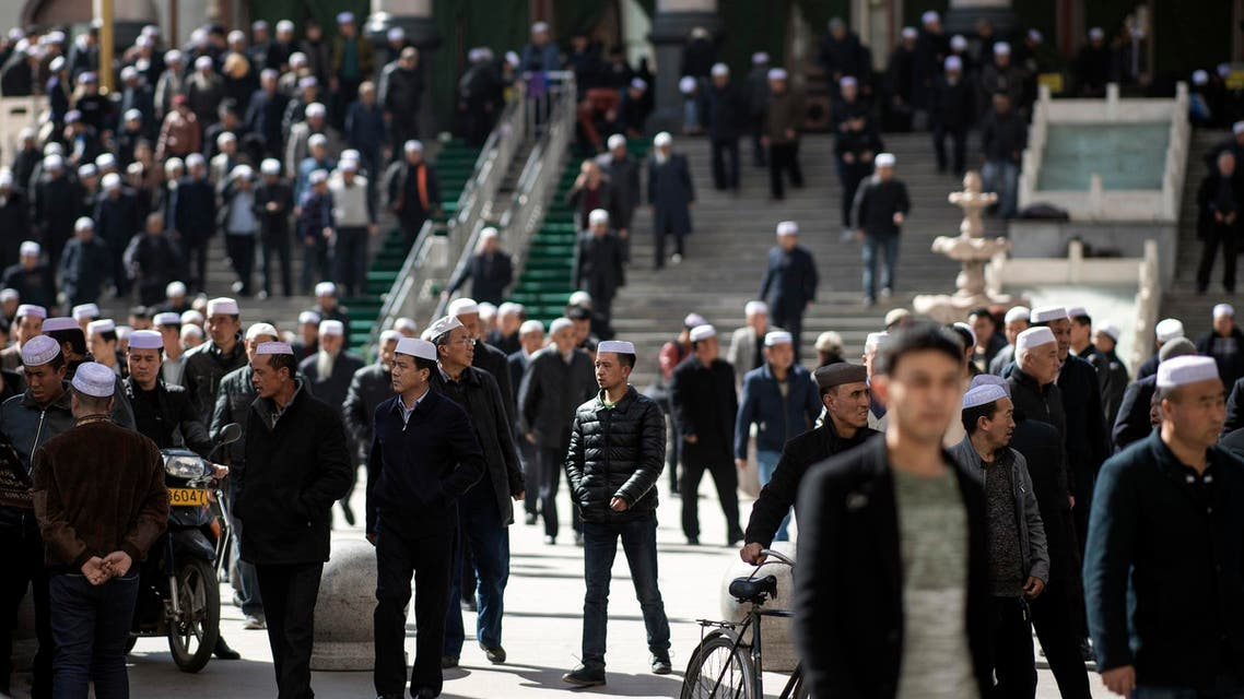Ethnic Hui Muslim men leaving Laohuasi Mosque after Friday prayers in Linxia, China's Gansu province, on March 2, 2018. (AFP)