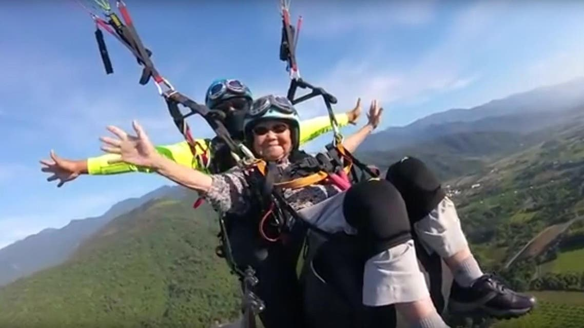 The paragliding company promised her a free ride when she becomes 100 years-old. (Youtube: World News)