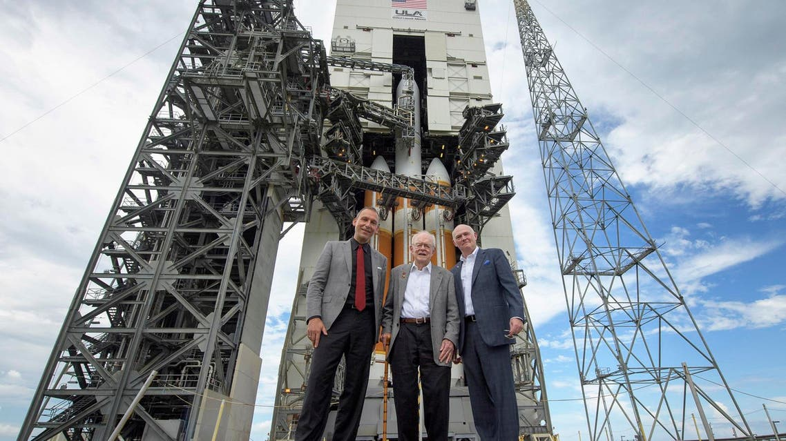 In this photo provided by NASA, astrophysicist Eugene Parker, center, stands with NASA Associate Administrator for the Science Mission Directorate Thomas Zurbuchen, left, and United Launch Alliance President and Chief Executive Officer Tory Bruno in front of the ULA Delta IV Heavy rocket with NASA's Parker Solar Probe onboard, Friday, Aug. 10, 2018 at Cape Canaveral Air Force Station, Fla. (AP)