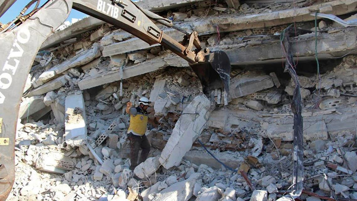 This photo provided by the Syrian Civil Defense White Helmets, which has been authenticated based on its contents and other AP reporting, shows Syrian White Helmet civil defense workers at the scene of an explosion that brought down a five-story building, in the village of Sarmada, near the Turkish border, north Syria, Sunday, Aug. 12, 2018. (AP)