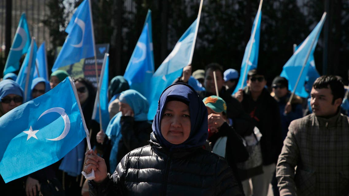 Uighurs and their supporters rally across the street from United Nations headquarters in New York, Thursday, March 15, 2018. (AP)