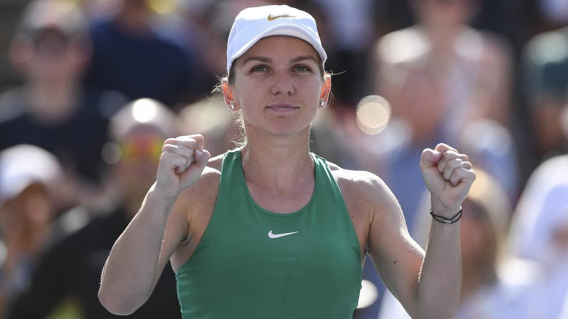 Simona Halep of Romania celebrates her 7-6, 3-6, 6-4 victory against Sloane Stephens in the final during day seven of the Rogers Cup on August 12, 2018 in Montreal, Quebec, Canada. (AFP)