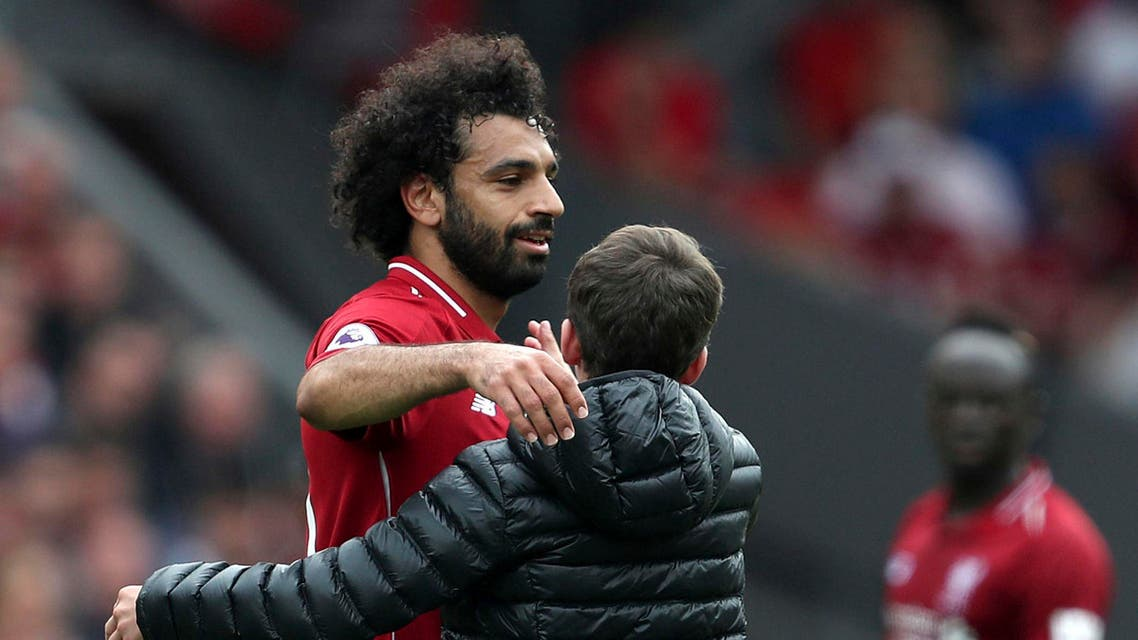 Salah dealt with the incident by hugging the boy and whispering words into his ear amid a clapping audience.(AP)