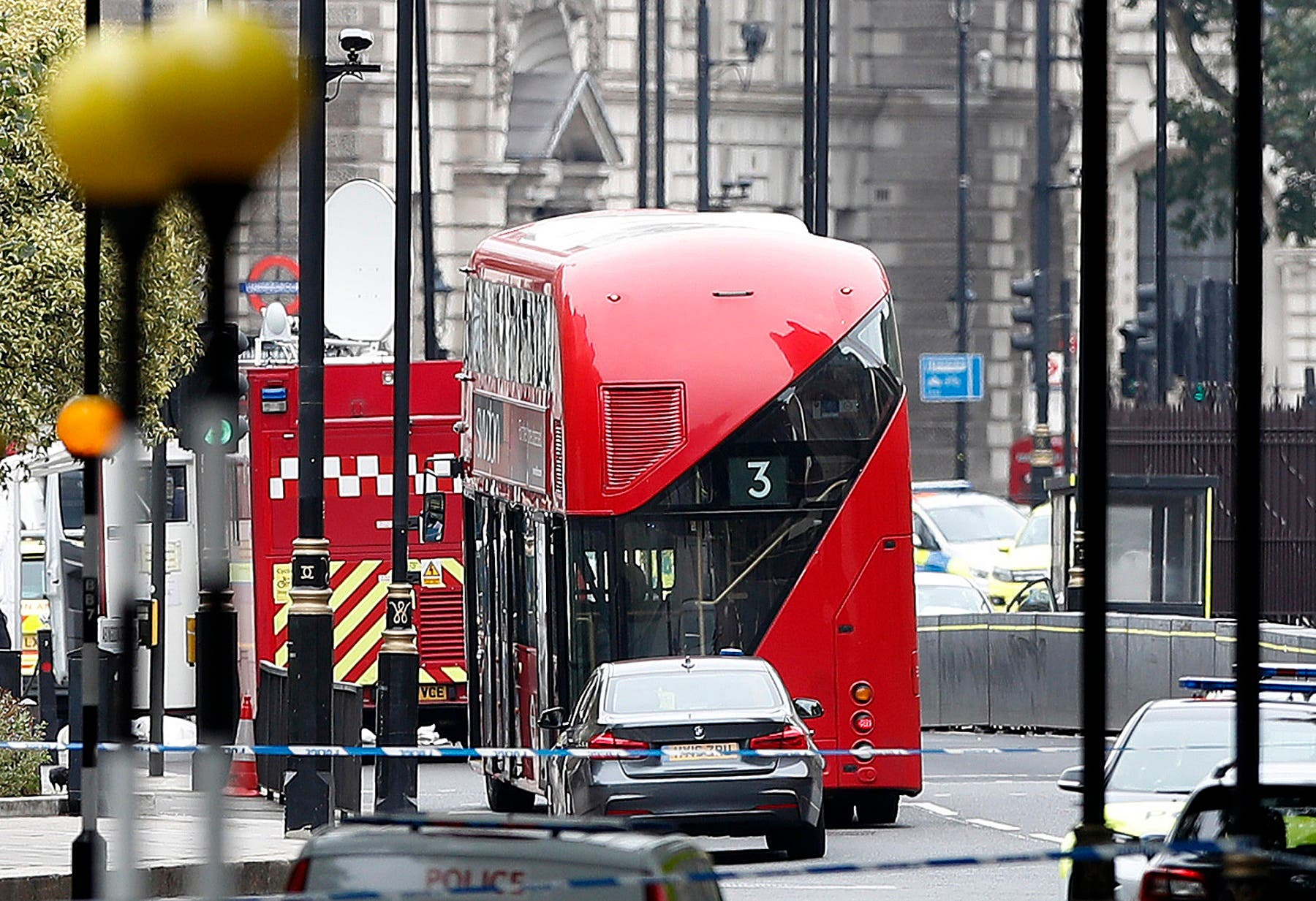 A car that crashed into security barriers outside the Houses of Parliament stands to the right of a bus in London, Tuesday, Aug. 14, 2018. (AP)