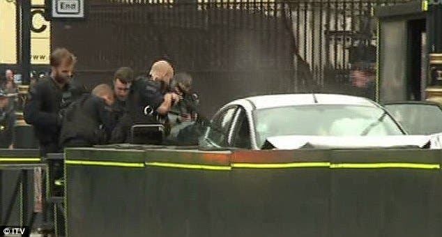 British armed police respond to car crash outside parliament