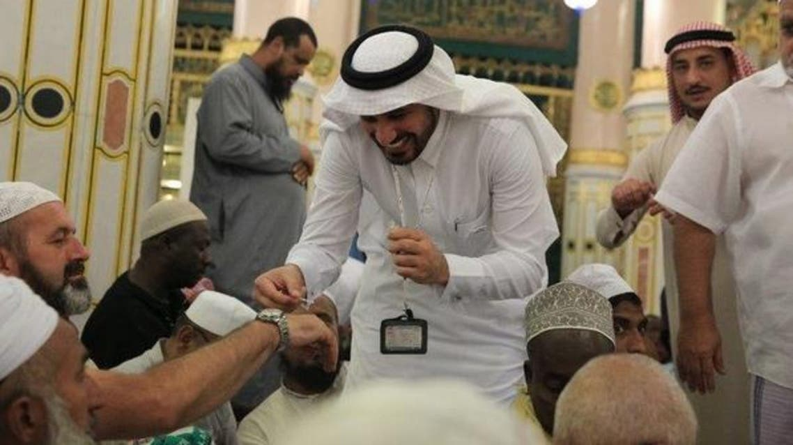 Pictures show some of the employees welcoming Hajj pilgrims by applying musk perfume on their hands, celebrating their arrival to this holy area. (Supplied)