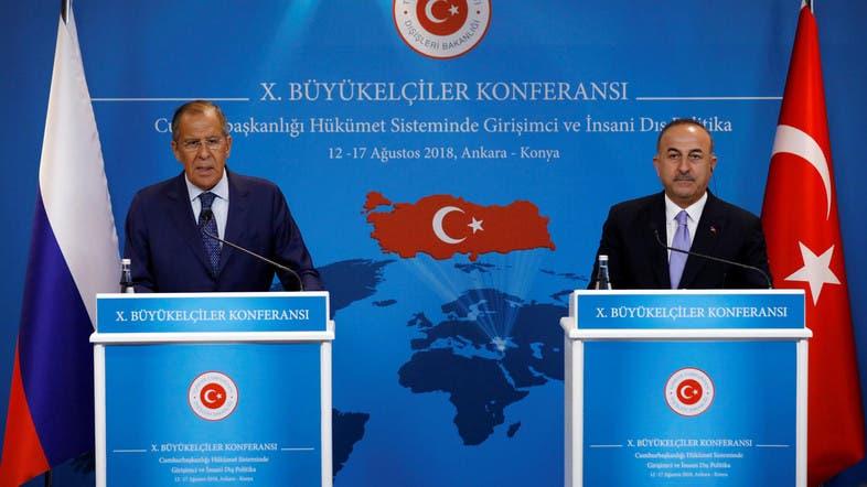 تشاوش أوغلو ولافروف خلال مؤتمر صحافي في أنقرة