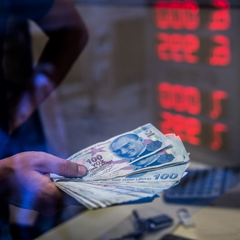 Turkish lira slumps to near record lows on sacking of central bank chief