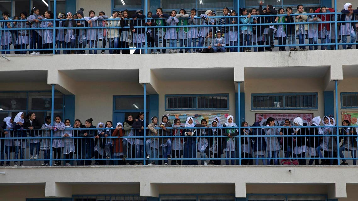 "Refugee school girls fly kites during the ""Kites of Dignity"" event at the UNRWA Rimal Girls Preparatory school in Gaza City, Monday, March 12, 2018.(AP)"
