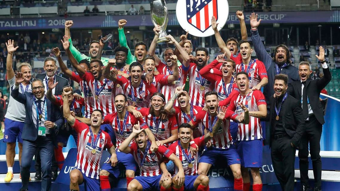 Atletico Madrid teammates celebrate with the trophy after winning the UEFA Super Cup final match against Real Madrid  in Tallinn, Estonia. (AP)