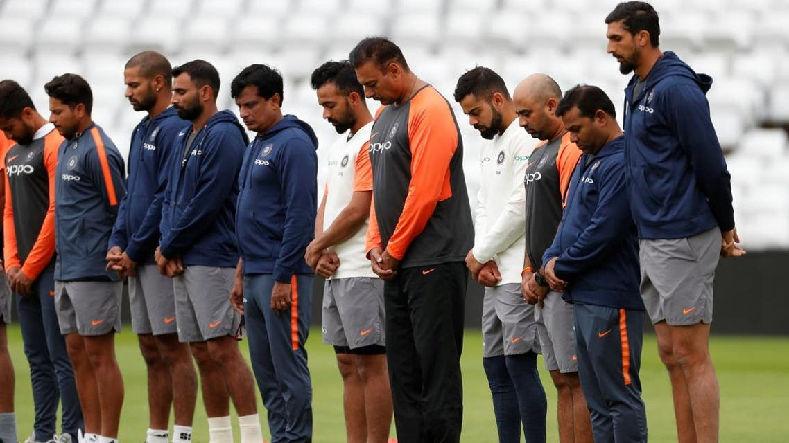 India's Virat Kohli, head coach Ravi Shastri and team mates during a minutes silence in memory of former India player Ajit Wadekar during nets at Trent Bridge, Nottingham, Britain, on August 16, 2018. (Reuters)