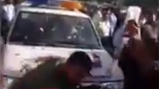 WATCH: Crowd surrounds Iranian policemen who brutally beat street vendor