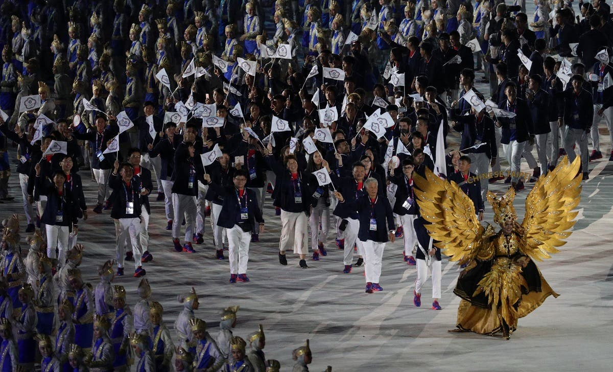 Athletes from Chinese Taipei march during the opening ceremony at the GBK Main Stadium of Asian Games at Jakarata, Indonesia. (Reuters)