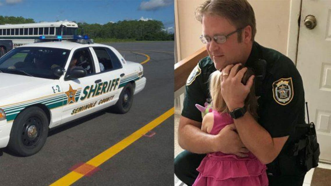 A dash camera shows Deputy Bill Dunn running to save the girl after he had received reports of her being inside the car. (Supplied)