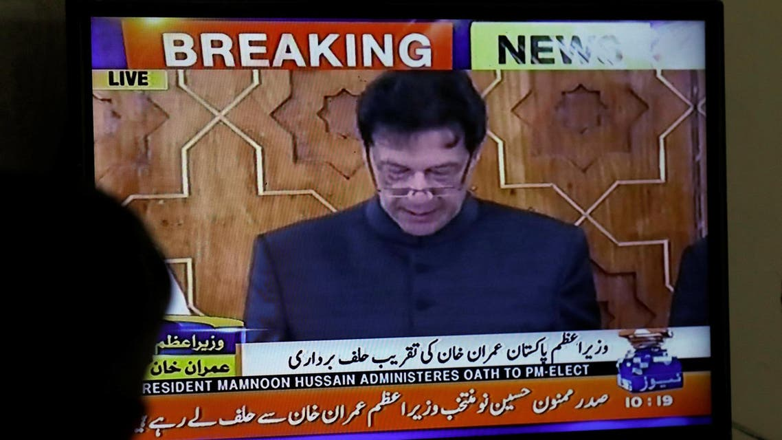 a television screen displaying cricketer-turned-politician Imran Khan swearing in as Prime Minister of Pakistan, in Karachi, Pakistan August 18, 2018. (AFP)