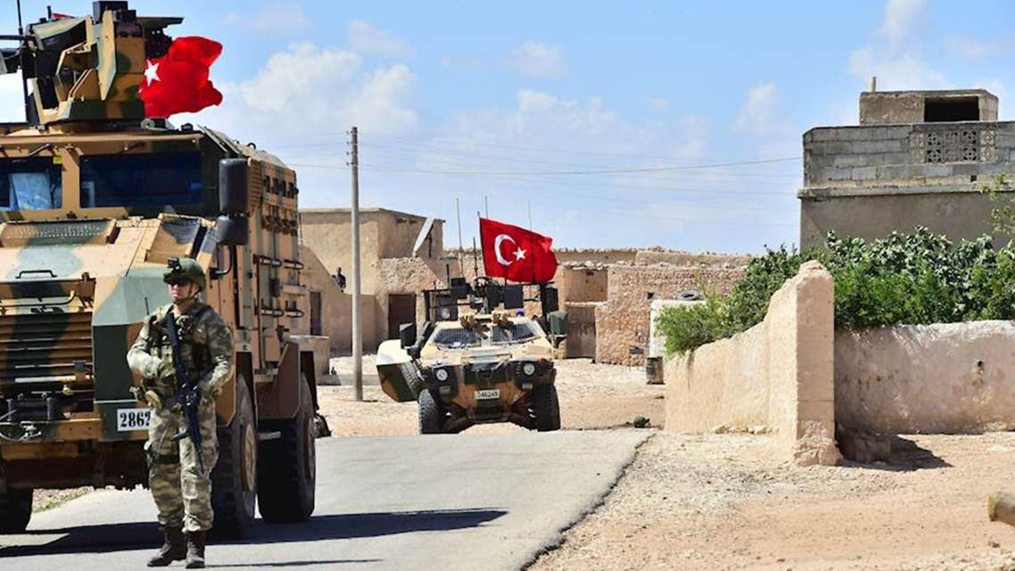 A handout picture realeased by the Turkish Armed Forces shows Turkish soldiers accompanied by armoured vehicles patrolling between the city of Manbij in northern Syria and an area it controls after a 2016-2017 military incursion on June 18, 2018. Turkey said it had started military patrols in an area around the Kurdish-held city of Manbij, in line with an agreement with the United States to scale down tensions in the region.