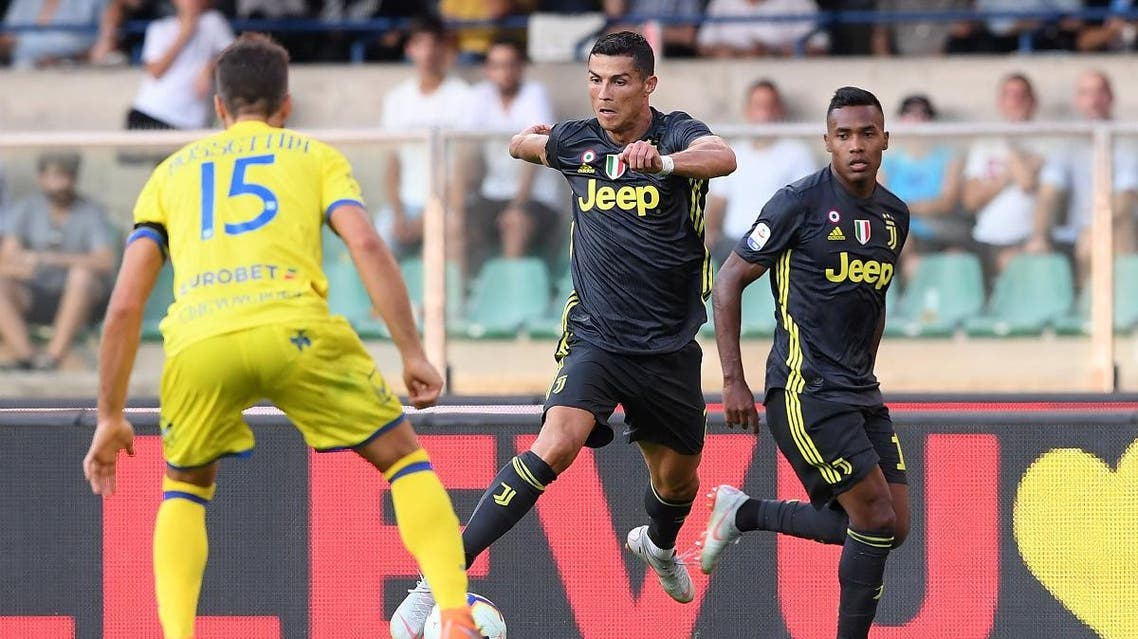 Juventus' Cristiano Ronaldo in action with Chievo Verona's Luca Rossettini. (Reuters)
