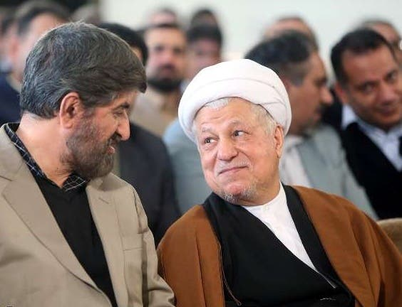 هاشمي رفسنجاني(إلى اليمين)
