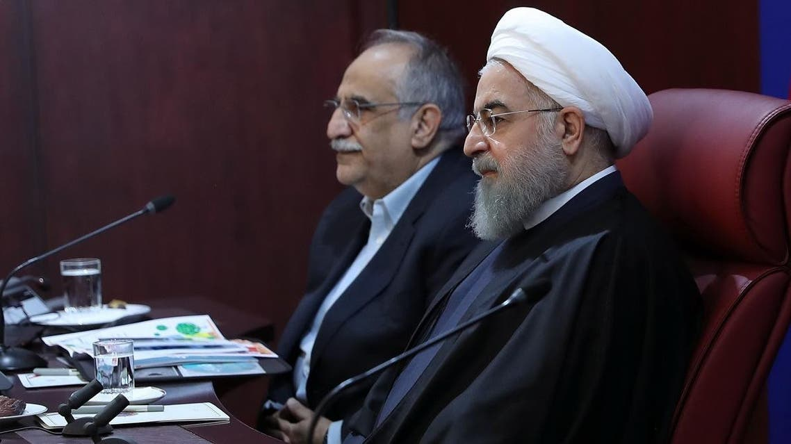 Iranian President Hassan Rouhani (R) sitting next to Minister of Economy, Masoud Karbasian, during a meeting with members of the ministry on January 8, 2018, in Tehran. (AFP)