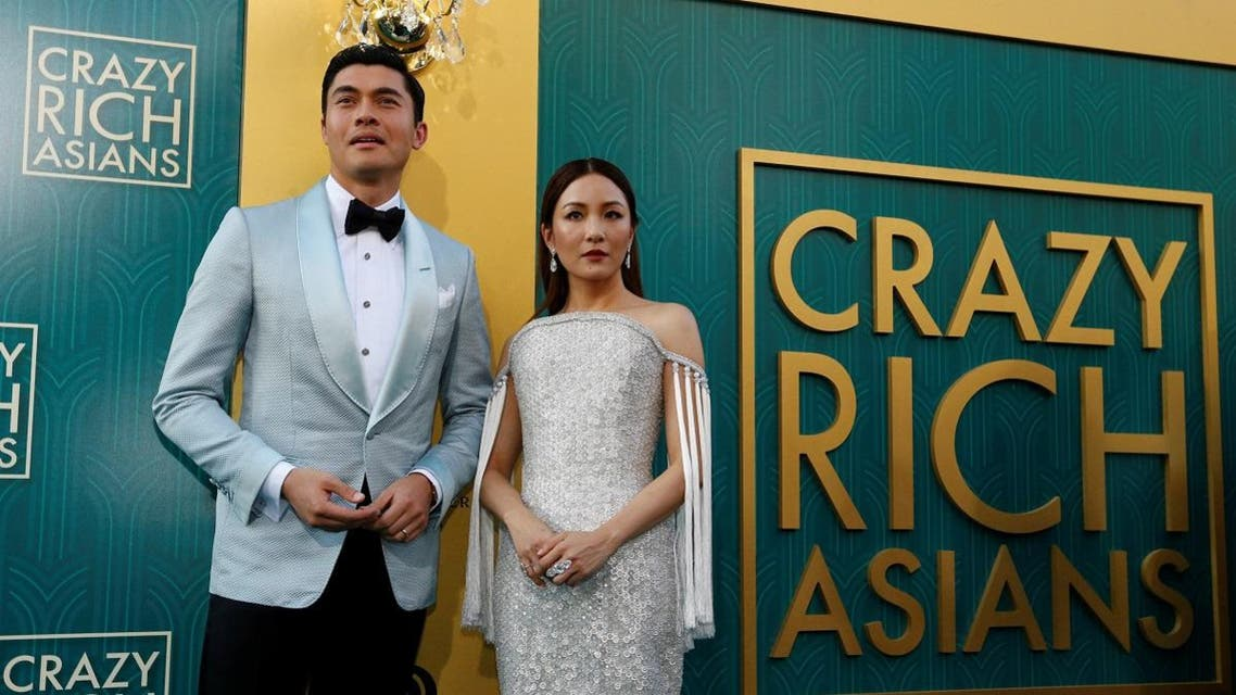 """Cast members Henry Golding and Constance Wu pose at the premiere for """"Crazy Rich Asians"""" in Los Angeles. (Reuters)"""