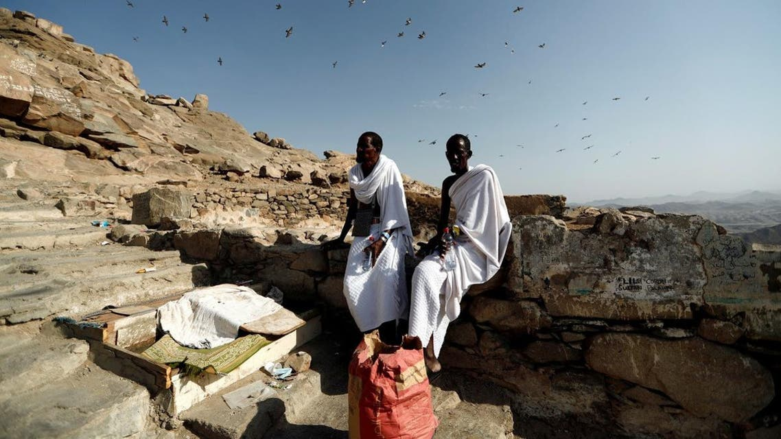 Muslim pilgrims from Somalia rest while they climb the Mount Al-Noor, where Prophet Mohammad received the first words of the Quran through Gabriel in the Hera cave. (Reuters)