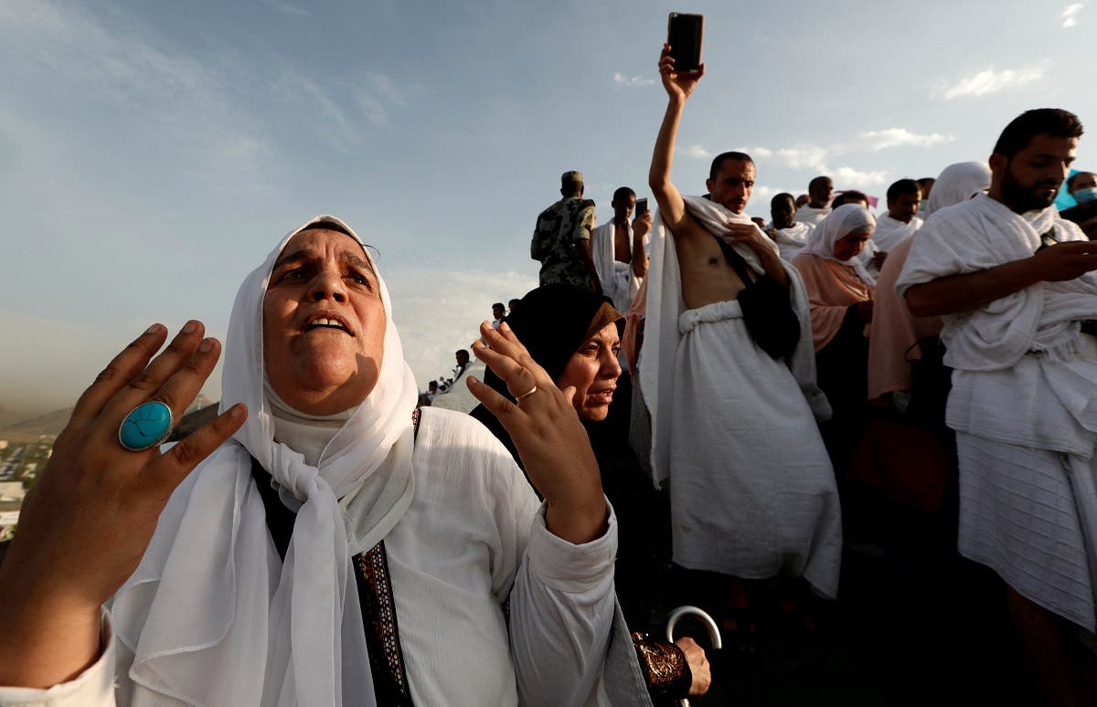 A Muslim pilgrim prays as she gather with others on Mount Mercy on the plains of Arafat during the annual haj pilgrimage, outside the holy city of Mecca. (Reuters)