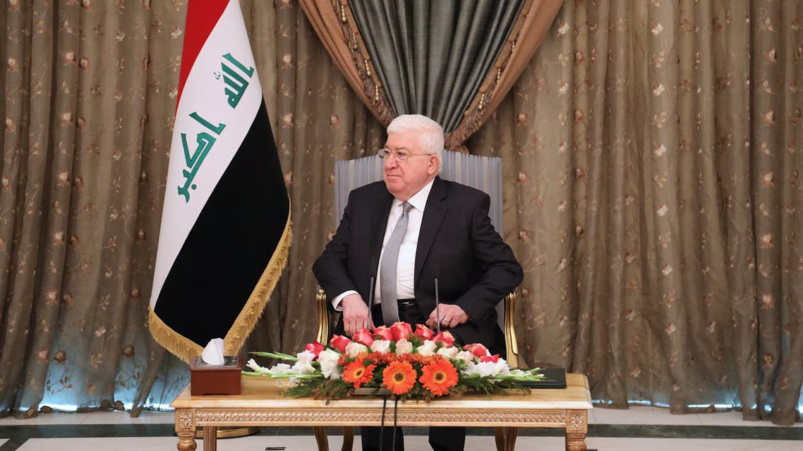 """Iraqi President Fuad Masum is seen during a meeting with France's Foreign Minister in the capital Baghdad on February 12, 2018. Le Drian urged Iraq to push for national reconciliation with its minority Sunni and Kurd communities ahead of """"inclusive"""" elections."""
