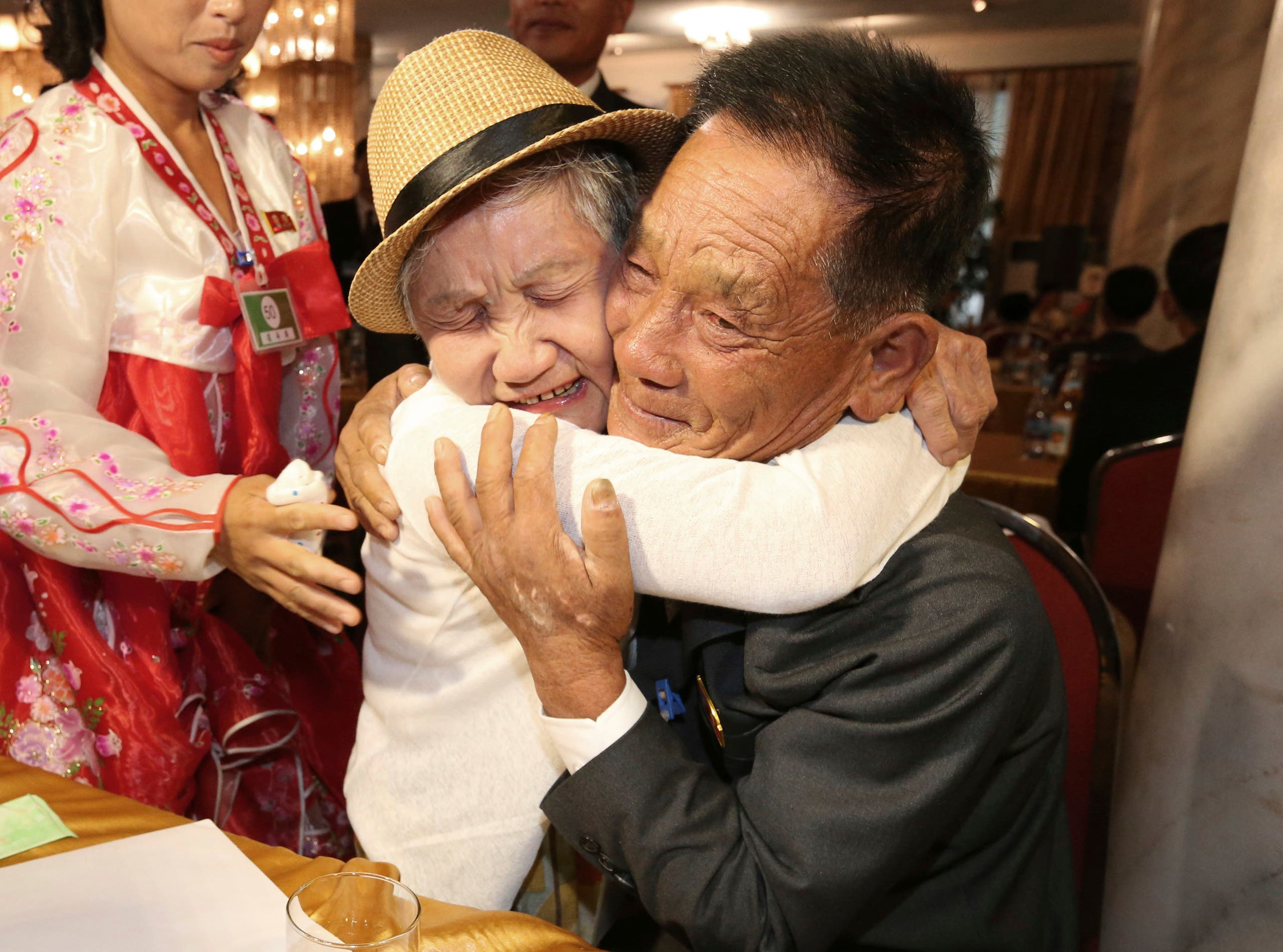 Emotional moments of reunion between South and North Korean families. (AP)