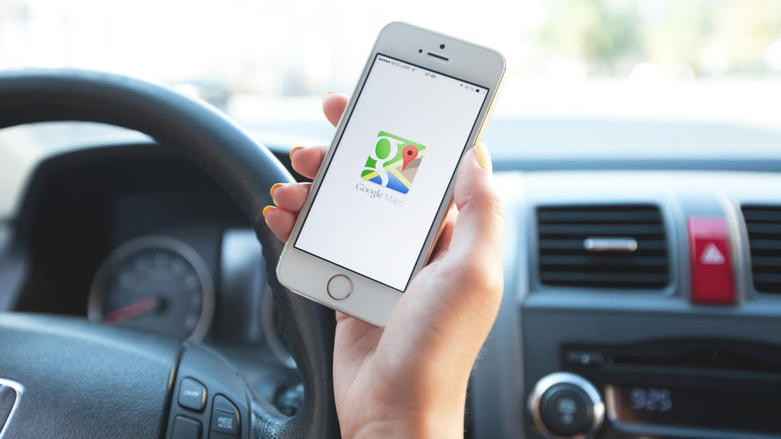 Google Maps navigation on Apple iPhone in use. - Stock image