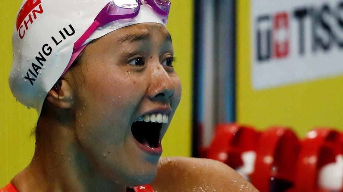 Liu Xiang of China celebrates after winning the gold medal and breaking the world record. (Reuters)