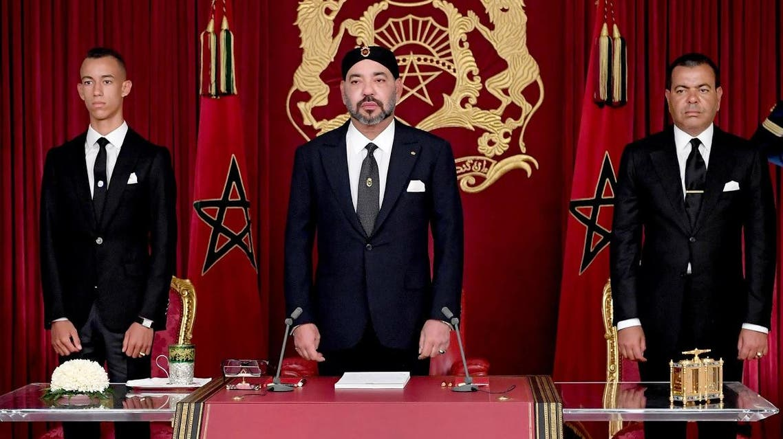 Morocco's King Mohammed VI (C) delivering a speech to mark the 19th anniversary of his accession to the throne, beside his brother Prince Moulay Rachid (R) and son Hassan III, in Al Hoceima on July 29, 2018. (AFP)