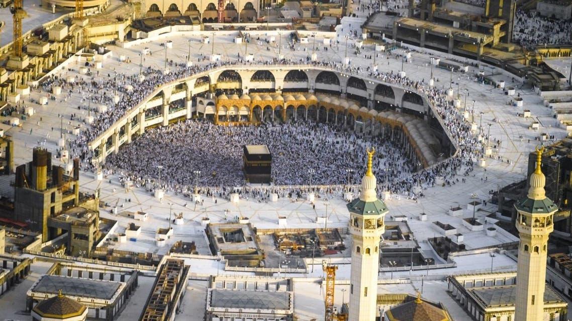 Muslim pilgrims walk to cast their stones at a pillar symbolising Satan during the annual haj pilgrimage in Mena, Saudi Arabia August 22, 2018. REUTERS/Zohra Bensemra