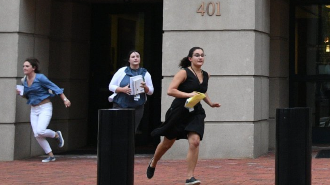 After the end of a trial session for former director of Donald Trump's presidential campaign, Paul Manafort, journalists rushed out of court running. (Supplied)