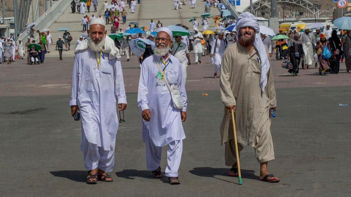 Muslim pilgrims walk towards Jamarat to cast stones at three huge stone pillars in the symbolic stoning of the devil on the last day of the annual hajj pilgrimage in Mina, outside the holy city of Mecca. (AP)