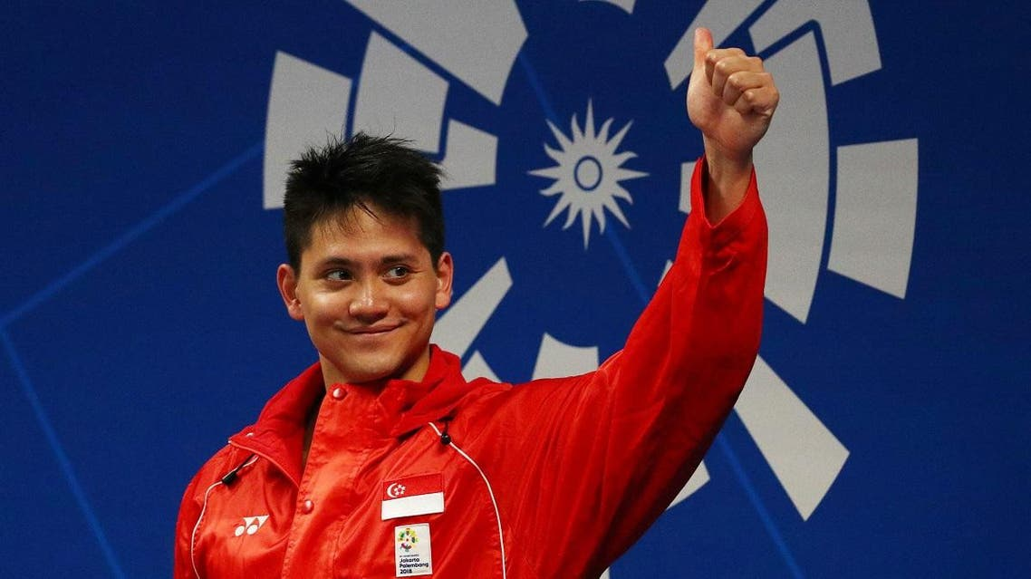 Gold medalist Joseph Isaac Schooling of Singapore during the medal ceremony. (Reuters)